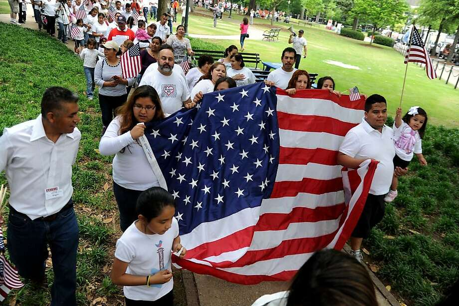 Supporters of immigration reform march at Linn Park in Birmingham, Ala., Wednesday, May 1, 2013.  (AP Photo/AL.com, Mark Almond) MAGS OUT Photo: Mark Almond, Associated Press
