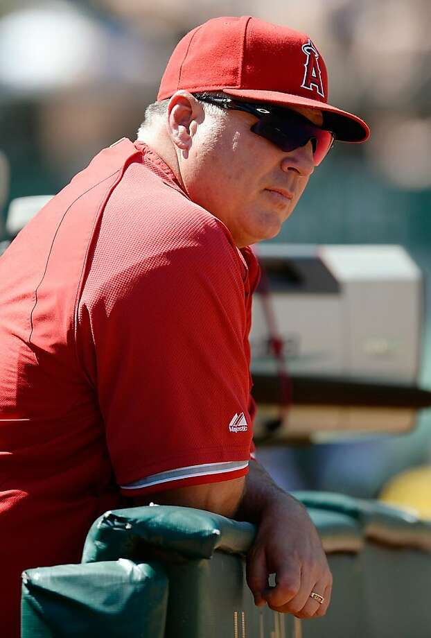 OAKLAND, CA - MAY 01:  Manager Mike Scioscia #14 of the Los Angeles Angels of Anaheim looks on from the end of the dugout against the Oakland Athletics in the eighth inning at O.co Coliseum on May 1, 2013 in Oakland, California. The Angels won the game 5-4. (Photo by Thearon W. Henderson/Getty Images) Photo: Thearon W. Henderson, Getty Images