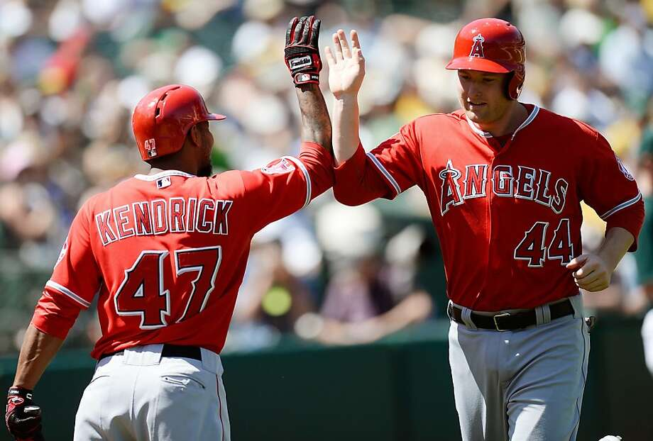 OAKLAND, CA - MAY 01:  Mark Trumbo #44 of the Los Angeles Angels of Anaheim is congratulated by Howie Kendrick #47 after Trumbo hit a solo home run against the Oakland Athletics in the six inning at O.co Coliseum on May 1, 2013 in Oakland, California.  (Photo by Thearon W. Henderson/Getty Images) Photo: Thearon W. Henderson, Getty Images