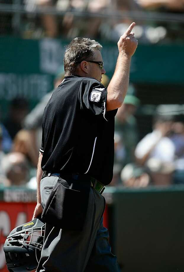 OAKLAND, CA - MAY 01:  Home plate umpire Gary Cederstrom #38 indicates home run for Mark Trumbo #44 of the Los Angeles Angels of Anaheim against the Oakland Athletics in the six inning at O.co Coliseum on May 1, 2013 in Oakland, California. Cederstrom and the umpiring crew was ask  by manager Mike Scioscia of the Angels to review the wether the ball hit by Trumbo was a home run or not.  (Photo by Thearon W. Henderson/Getty Images) Photo: Thearon W. Henderson, Getty Images