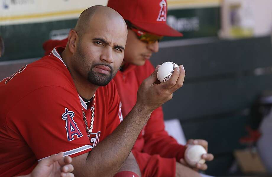 Los Angeles Angels first baseman Albert Pujols sits in the dugout during a baseball game against the Oakland Athletics in Oakland, Calif., Wednesday, May 1, 2013. The Angels won 5-4. (AP Photo/Jeff Chiu) Photo: Jeff Chiu, Associated Press