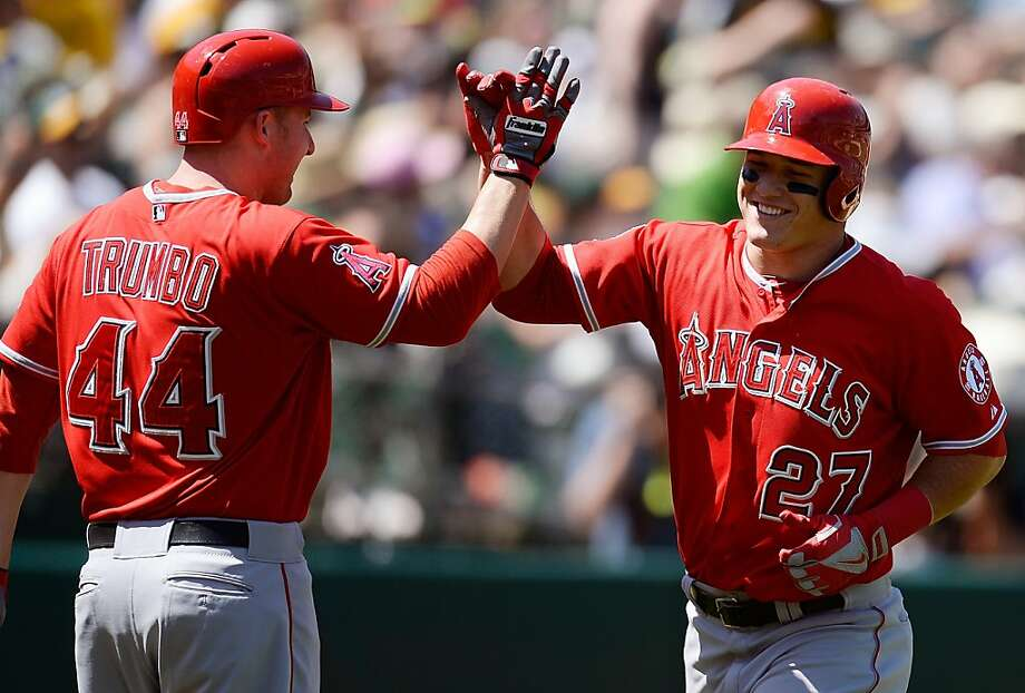 OAKLAND, CA - MAY 01:  Mike Trout #27 of the Los Angeles Angels of Anaheim is congratulated by Mark Trumbo #44 after Trout hit a solo home run against the Oakland Athletics in the six inning at O.co Coliseum on May 1, 2013 in Oakland, California.  (Photo by Thearon W. Henderson/Getty Images) Photo: Thearon W. Henderson, Getty Images