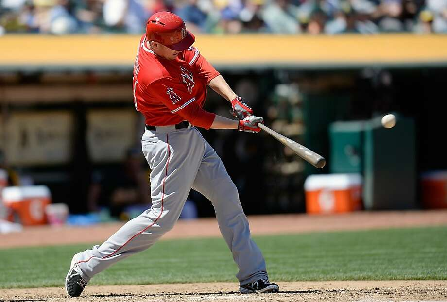 OAKLAND, CA - MAY 01:  Mark Trumbo #44 of the Los Angeles Angels of Anaheim hits a solo home run against the Oakland Athletics in the six inning at O.co Coliseum on May 1, 2013 in Oakland, California.  (Photo by Thearon W. Henderson/Getty Images) Photo: Thearon W. Henderson, Getty Images