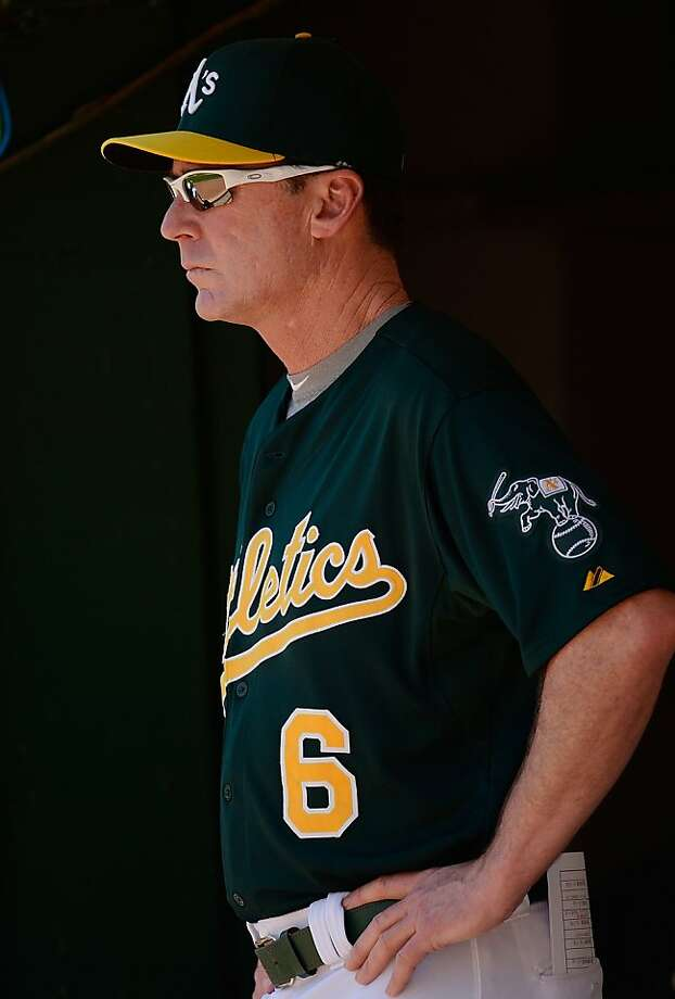 OAKLAND, CA - MAY 01: Manager Bob Melvin #6 of the Oakland Athletics looks on from the dugout against the Los Angeles Angels of Anaheim in the second inning at O.co Coliseum on May 1, 2013 in Oakland, California.  (Photo by Thearon W. Henderson/Getty Images) Photo: Thearon W. Henderson, Getty Images