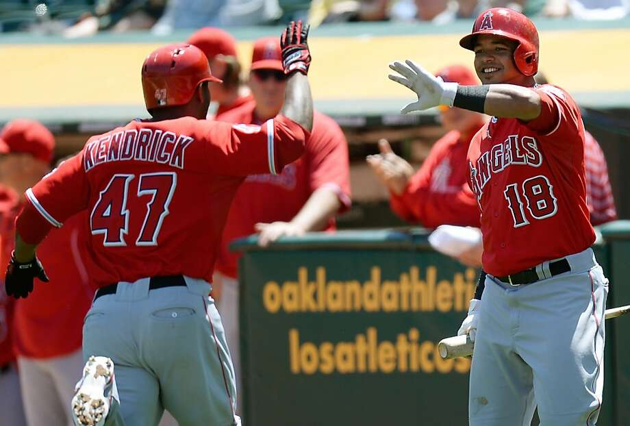 OAKLAND, CA - MAY 01:  Howie Kendrick #47 of the Los Angeles Angels of Anaheim is congratulated by Luis Jimenez #18 after Kendrick hit a solo home run against the Oakland Athletics in the second inning at O.co Coliseum on May 1, 2013 in Oakland, California.  (Photo by Thearon W. Henderson/Getty Images) Photo: Thearon W. Henderson, Getty Images