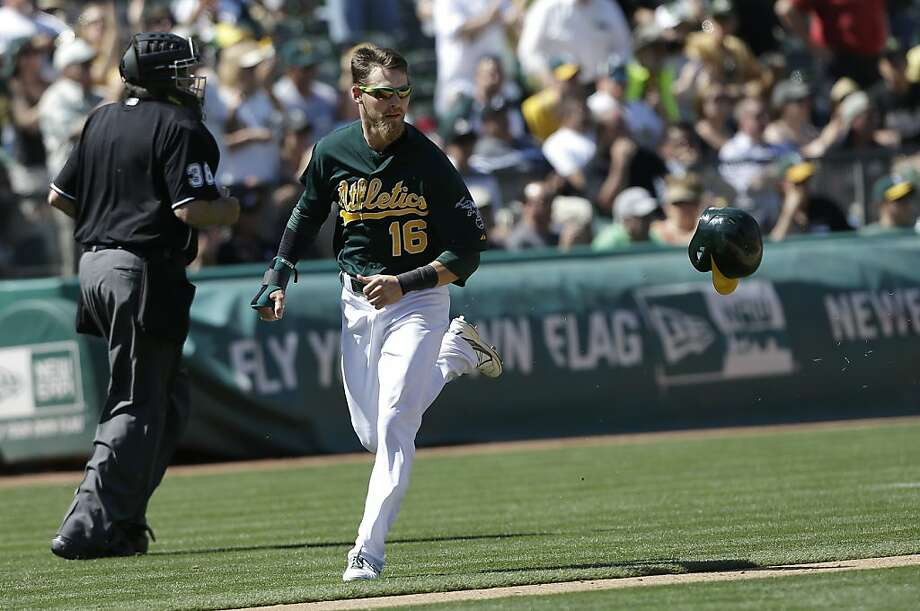 Oakland Athletics' Josh Reddick (16) scores against the Los Angeles Angels during the eighth inning of a baseball game in Oakland, Calif., Wednesday, May 1, 2013. The Angels won 5-4. (AP Photo/Jeff Chiu) Photo: Jeff Chiu, Associated Press
