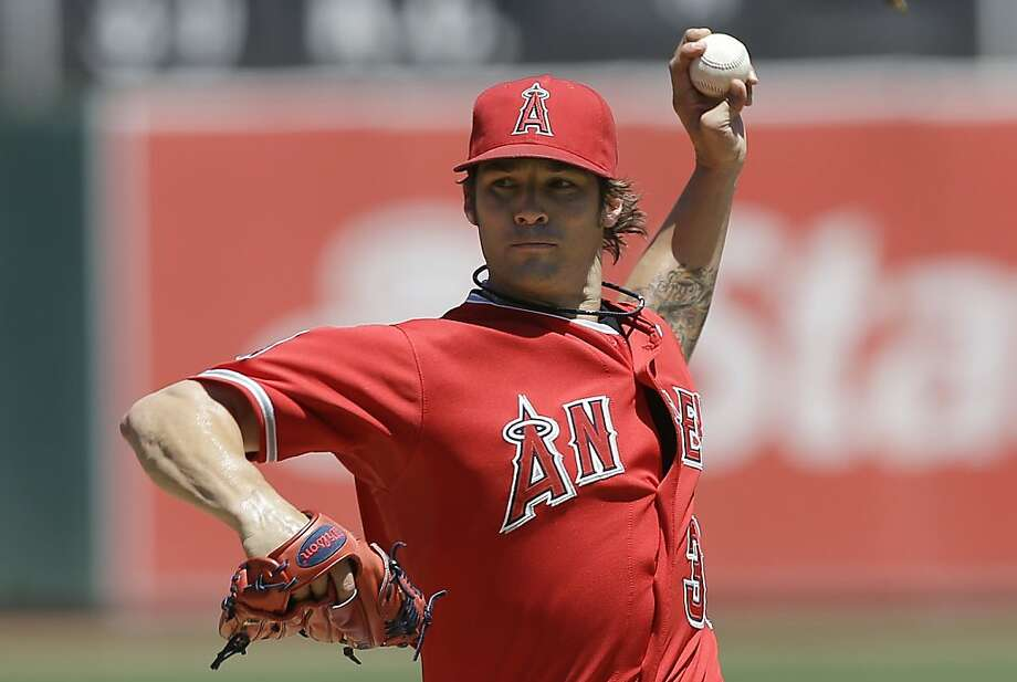 Los Angeles Angels pitcher C.J. Wilson delivers against the Oakland Athletics during the first inning of a baseball game in Oakland, Calif., Wednesday, May 1, 2013. (AP Photo/Jeff Chiu) Photo: Jeff Chiu, Associated Press