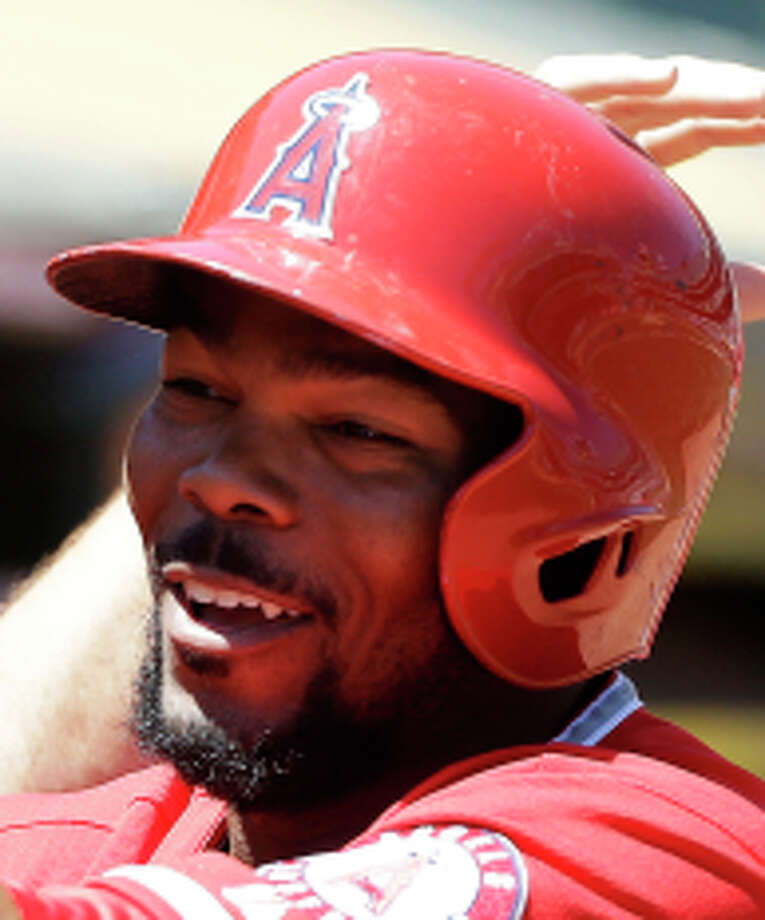 Los Angeles Angels' Howie Kendrick (47) celebrates with teammates after hitting a solo home run off of Oakland Athletics pitcher Tommy Milone in the second inning of a baseball game in Oakland, Calif., Wednesday, May 1, 2013. (AP Photo/Jeff Chiu) Photo: Jeff Chiu / Associated Press / AP