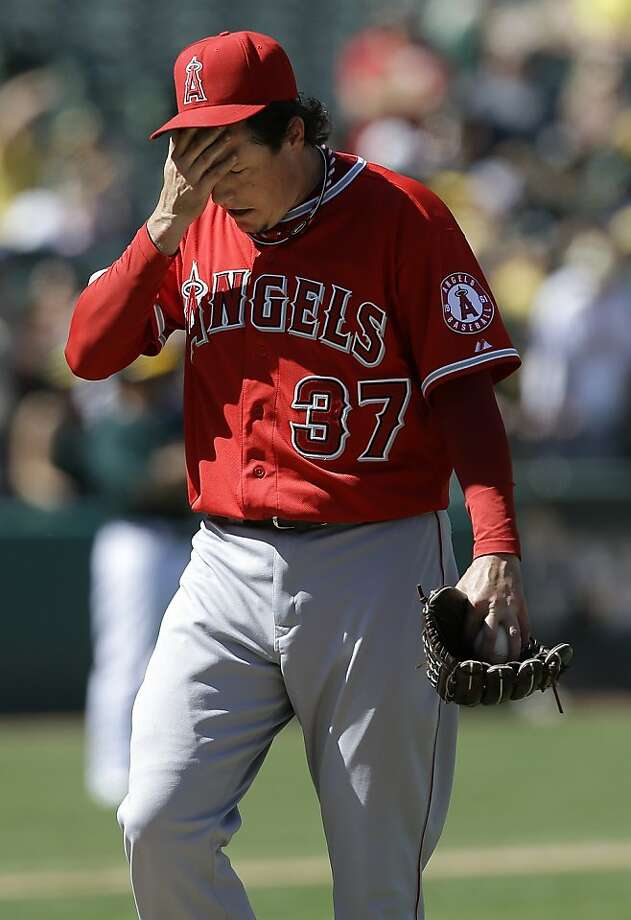 Los Angeles Angels pitcher Scott Downs (37) walks to the dugout after being relieved during the eighth inning of a baseball game against the Oakland Athletics in Oakland, Calif., Wednesday, May 1, 2013. The Angels won 5-4. (AP Photo/Jeff Chiu) Photo: Jeff Chiu, Associated Press