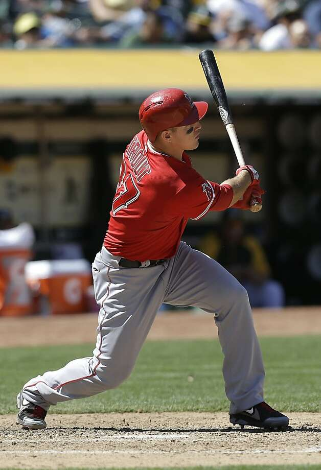 Los Angeles Angels' Mike Trout hits a triple against the Oakland Athletics during the eighth inning of a baseball game in Oakland, Calif., Wednesday, May 1, 2013. (AP Photo/Jeff Chiu) Photo: Jeff Chiu, Associated Press