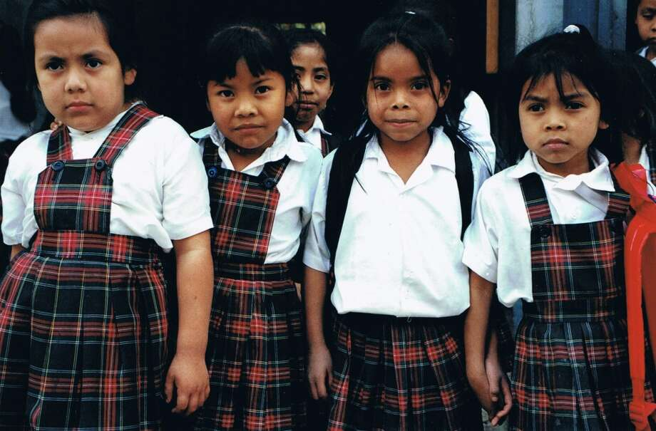 "Children pose for a photograph at the San Pedro La Laguna, Guatemala Compassion International site that was included in the study ""Does International Child Sponsorship Work? A Six-Country Study of Impacts on Adult Life Outcomes"". Bruce Wydick is the lead author of the study, which was published in the April issue of the Journal of Political Economy."