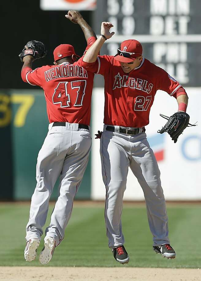 Los Angeles Angels second baseman Howie Kendrick (47) and left fielder Mike Trout (27) celebrate after the final out of the ninth inning of a baseball game against the Oakland Athletics in Oakland, Calif., Wednesday, May 1, 2013. The Angels won 5-4. (AP Photo/Jeff Chiu) Photo: Jeff Chiu, Associated Press