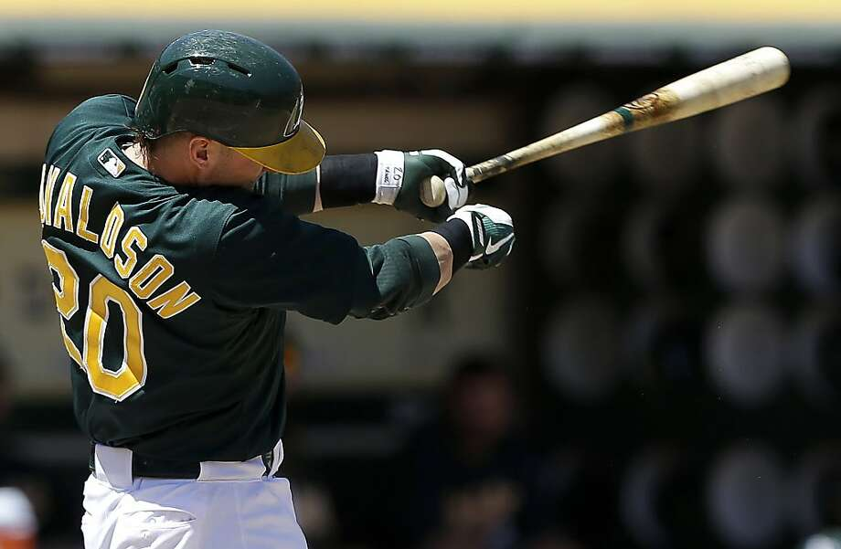 Oakland Athletics' Josh Donaldson (20) hits a double off Los Angeles Angels pitcher C.J. Wilson to score Yoenis Cespedes against the Los Angeles Angels during the third inning of a baseball game in Oakland, Calif., Wednesday, May 1, 2013. (AP Photo/Jeff Chiu) Photo: Jeff Chiu, Associated Press