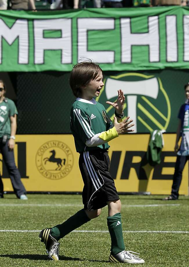 Atticus Lane Dupre, 8, celebrates after scoring a goal as his team, the Green Machine, play against the MLS Portland Timbers soccer team in Portland, Ore., Wednesday, May 1, 2013.  The Timbers and Make-A-Wish Oregon treated Atticus' team to a game at Jeld-Wen Field with more than 3,000 fans coming out to lend their support. Atticus missed the Green Machine's final match last fall because of cancer treatment.  (AP Photo/Don Ryan) Photo: Don Ryan, Associated Press