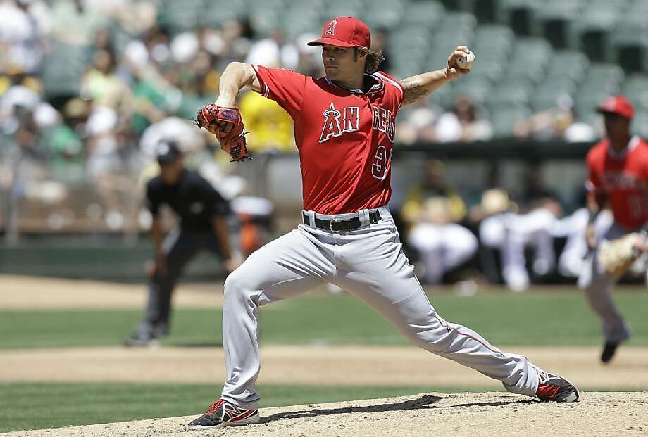 Los Angeles Angels pitcher C.J. Wilson delivers against the Oakland Athletics during the second inning of a baseball game in Oakland, Calif., Wednesday, May 1, 2013. (AP Photo/Jeff Chiu) Photo: Jeff Chiu, Associated Press