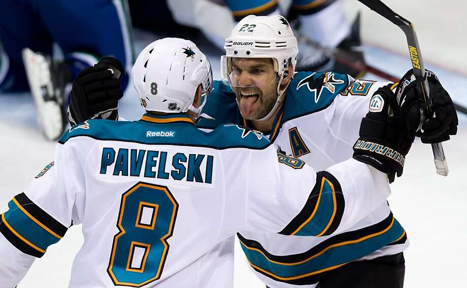 San Jose Sharks' Dan Boyle, right, celebrates his goal against the Vancouver Canucks with teammate Joe Pavelski during the third period in game 1 of an NHL Western Conference quarter-final playoff hockey series in Vancouver, British Columbia Wednesday May 1, 2013. (AP Photo/The Canadian Press, Darryl Dyck) Photo: Darryl Dyck, Associated Press
