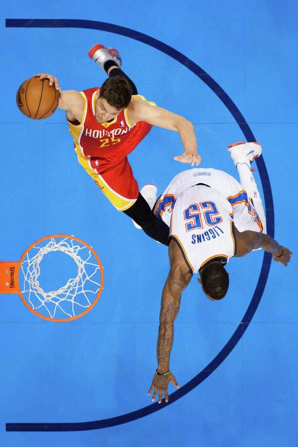 Rockets forward Chandler Parsons, left, gains the upper hand in a rebounding duel with Thunder guard DeAndre Liggins during first-half action of Game 5 of the first-round playoff series at Chesapeake Energy Arena on Wednesday night. Photo: Smiley N. Pool, Staff / © 2013  Houston Chronicle