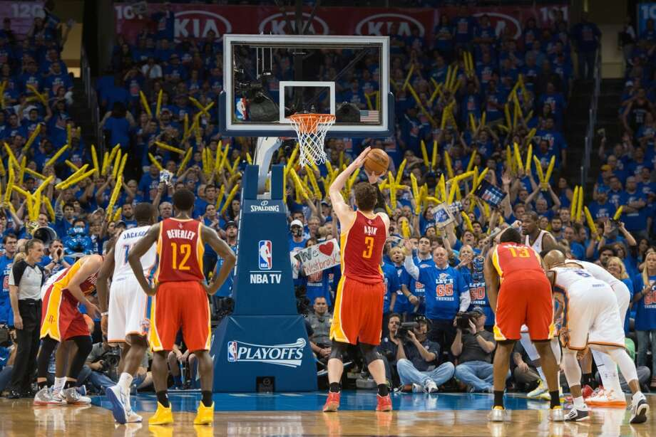 Rockets center Omer Asik shoots a free throw during the fourth quarter when the Thunder resorted to sending him to the line.   Asik fired made 9-of-14 free throws in the stretch.. Photo: Smiley N. Pool, Houston Chronicle