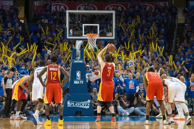 Rockets center Omer Asik shoots a free throw during the fourth quarter when the Thunder resorted to
