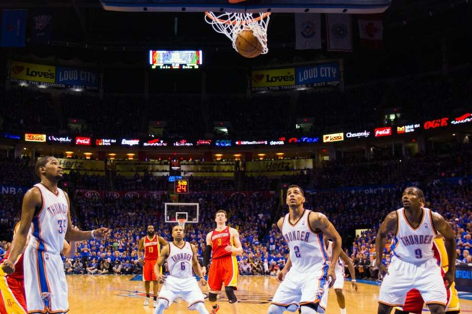 Thunder players Kevin Durant (35), Derek Fisher (6), Thabo Sefolosha (2) and Serge Ibaka (9) watch as a free throw by Rockets center Omer Asik (3) rips the net. Photo: Smiley N. Pool, Houston Chronicle