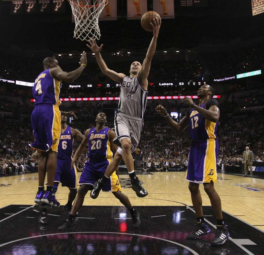 San Antonio Spurs' Manu Ginobili drives to the basket between Los Angeles Lakers' Antawn Jamison, (4), and Dwight Howard, (12), during the first second half of game 1 in the first round of the NBA Playoffs at the AT&T Center, Sunday, April 21, 2013. The Spurs won 91-79.