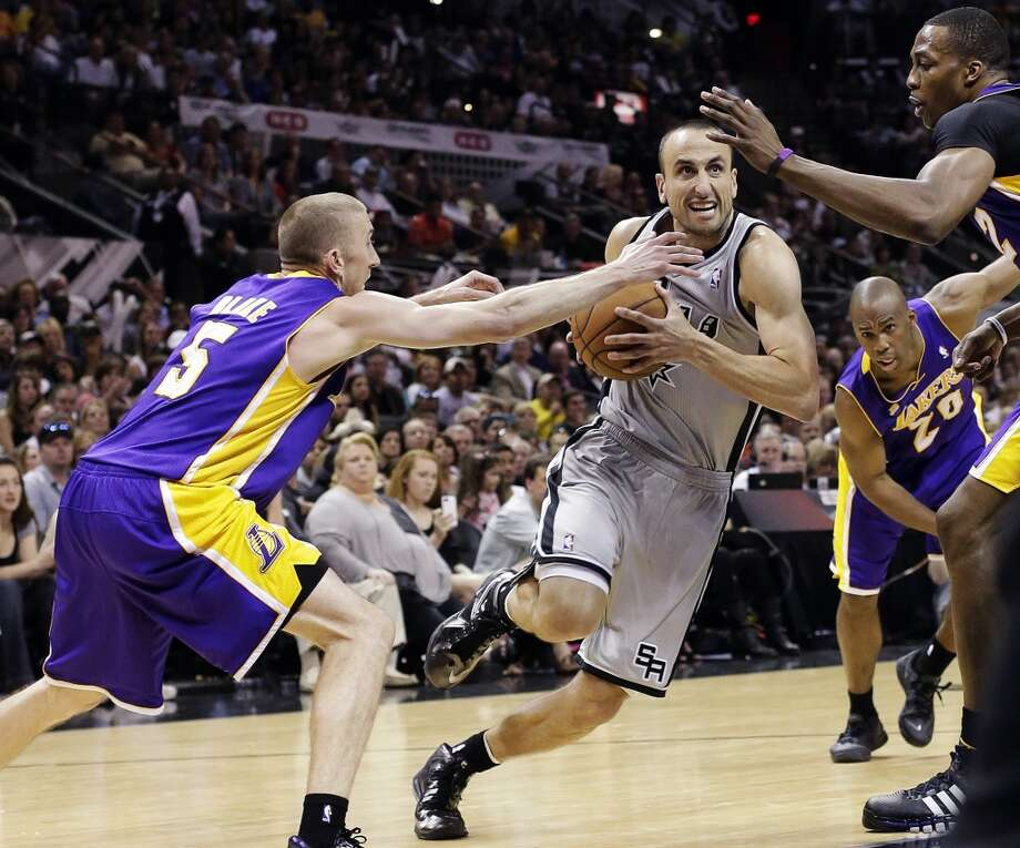 San Antonio Spurs' Manu Ginobili, center, of Argentina, drives between Los Angeles Lakers' Steve Blake, left, and Dwight Howard during the second half of Game 1 of their first-round NBA basketball playoff series, Sunday, April 21, 2013, in San Antonio. San Antonio won 91-79.