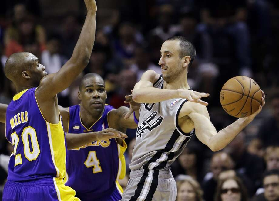 San Antonio Spurs' Manu Ginobili, right, of Argentina, is pressured by Los Angeles Lakers' Jodie Meeks (20) and Antawn Jamison (4) during the first half of Game 1 of their first-round NBA playoff basketball series, Sunday, April 21, 2013, in San Antonio.
