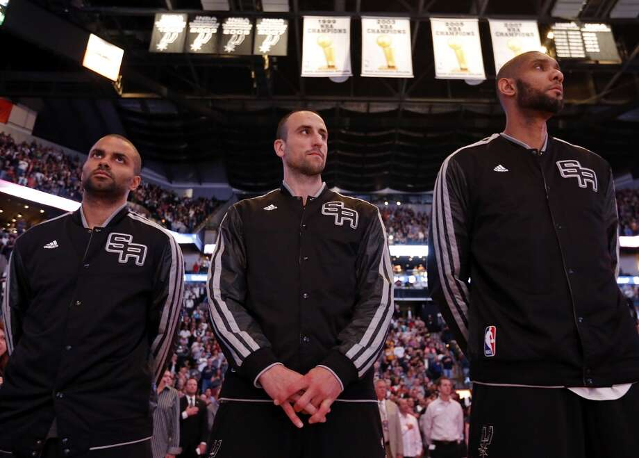 San Antonio Spurs' Tony Parker (from left), San Antonio Spurs' Manu Ginobili, and San Antonio Spurs' Tim Duncan stand during the national anthem before game 2 in the first round of the NBA Playoffs against the Los Angeles Lakers Wednesday April 24, 2013 at the AT&T Center.