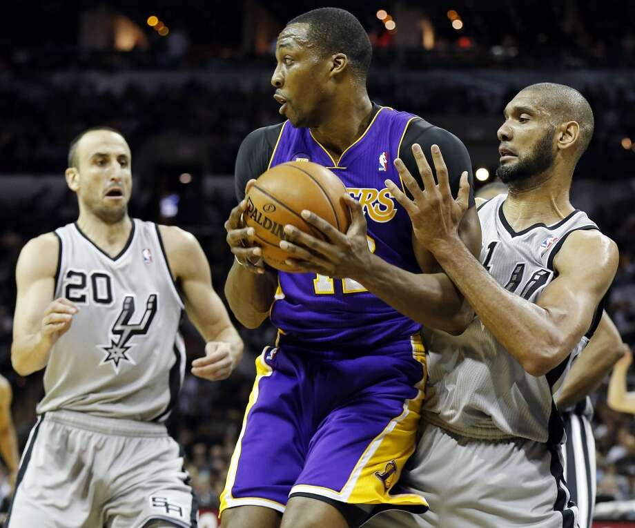 San Antonio Spurs' Tim Duncan defends Los Angeles Lakers' Dwight Howard as San Antonio Spurs' Manu Ginobili moves in on the play during first half action of game 2 in the first round of the NBA Playoffs Wednesday April 24, 2013 at the AT&T Center.