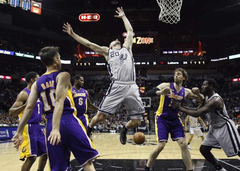 San Antonio Spurs' Manu Ginobili (20), of Argentina, loses control of the ball as Los Angeles Lakers' Steve Nash (10) defends against him during the first half of Game 2 of a first-round NBA basketball playoff series on Wednesday, April 24, 2013, in San Antonio, Texas.
