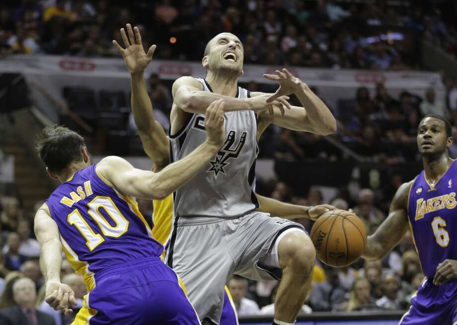 San Antonio Spurs' Manu Ginobili, center, of Argentina, loses control of the ball as Los Angeles Lakers' Steve Nash (10) defends against him during the first half of Game 2 of a first-round NBA basketball playoff series on Wednesday, April 24, 2013, in San Antonio, Texas.