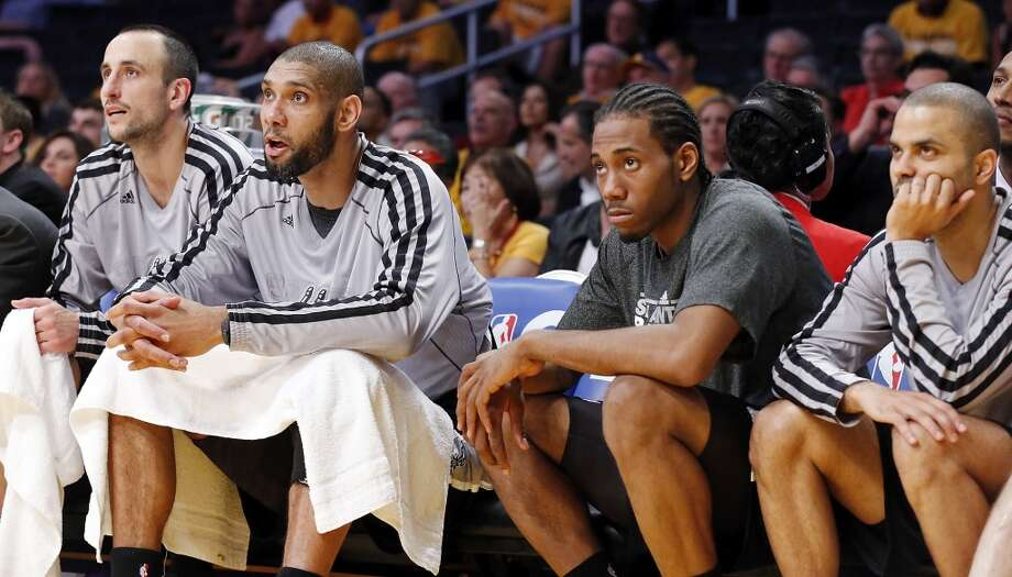 San Antonio Spurs' Manu Ginobili (from left), San Antonio Spurs' Tim Duncan, San Antonio Spurs' Kawhi Leonard and San Antonio Spurs' Tony Parker watch second half action of game 3 in the first round of the NBA Playoffs against the Los Angeles Lakers from the bench Friday April 26, 2013 at the Staples Center in Los Angeles, CA. The Spurs won 120-89.