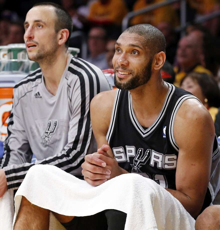 San Antonio Spurs' Manu Ginobili (left) and San Antonio Spurs' Tim Duncan watch second half action of game 3 in the first round of the NBA Playoffs against the Los Angeles Lakers from the bench Friday April 26, 2013 at the Staples Center in Los Angeles, CA. The Spurs won 120-89.