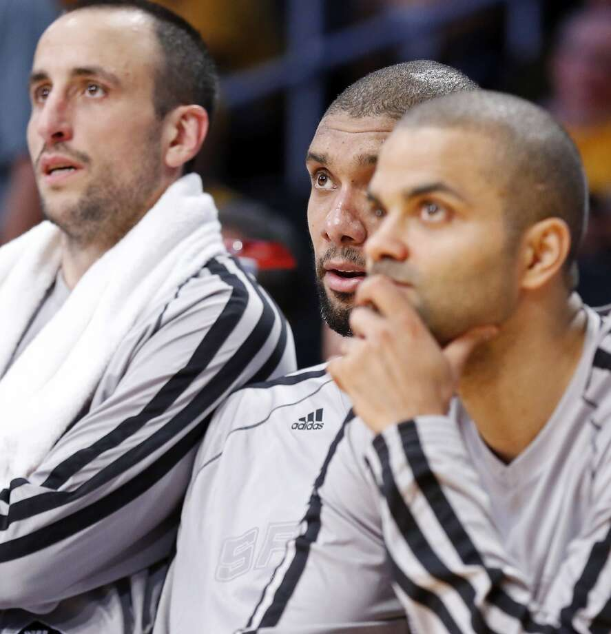 San Antonio Spurs' Manu Ginobili (from left), San Antonio Spurs' Tim Duncan, and San Antonio Spurs' Tony Parker watch second half action of game 3 in the first round of the NBA Playoffs against the Los Angeles Lakers from the bench Friday April 26, 2013 at the Staples Center in Los Angeles, CA. The Spurs won 120-89.