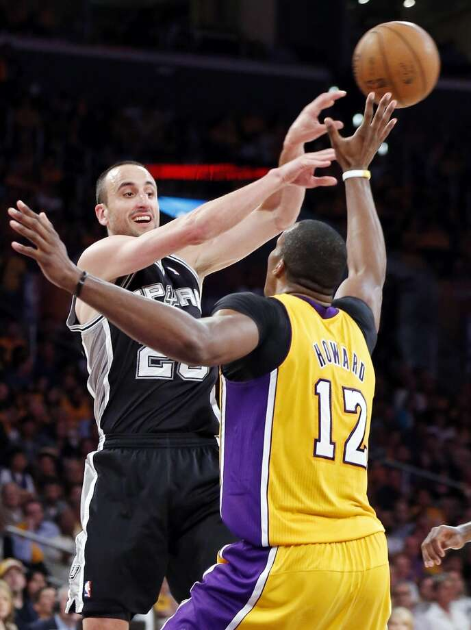 San Antonio Spurs' Manu Ginobili passes around Los Angeles Lakers' Dwight Howard during second half action of game 3 in the first round of the NBA Playoffs Friday April 26, 2013 at the Staples Center in Los Angeles, CA. The Spurs won 120-89.
