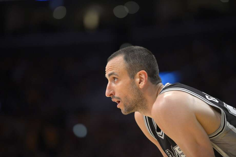 San Antonio Spurs guard Manu Ginobili, of Aregentina, looks on during the first half in Game 3 of a first-round NBA basketball playoff series against the Los Angeles Lakers, Friday, April 26, 2013, in Los Angeles.