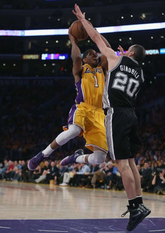 Darius Morris #1 of the Los Angeles Lakers is defended by Manu Ginobili #20 of the San Antonio Spurs in the second half during Game Three of the Western Conference Quarterfinals of the 2013 NBA Playoffs at Staples Center on April 26, 2013 in Los Angeles, California. The Spurs defeated the Lakers 120-89.