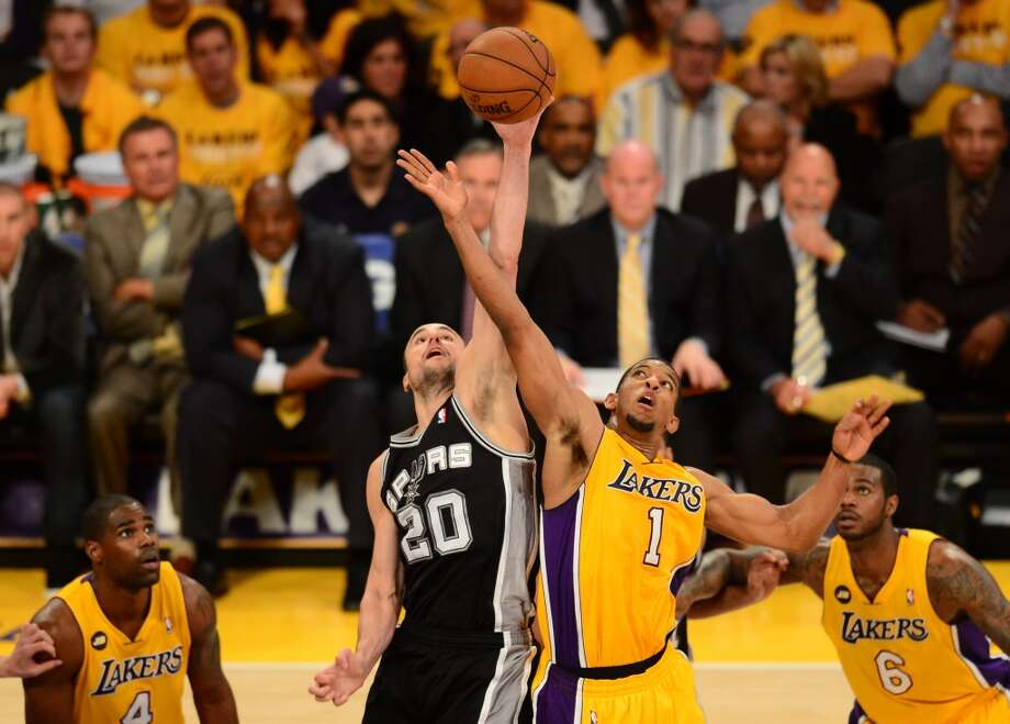 Darius Morris (R) of the Los Angeles Lakers  and Manu Ginobili (L) of the San Antonio Spurs work the tipoff during Game Three of the NBA Western Conference Quarterfinal Playoffs at Staples Center in Los Angeles, California on April 26, 2013.