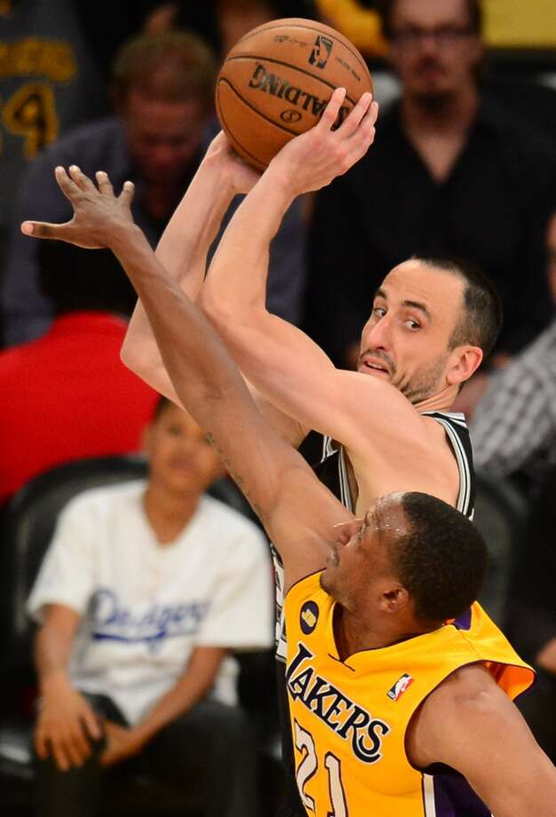 Manu Ginobili  (L) of the San Antonio Spurs is guarded  by  Chris Duhon (R) of the Los Angeles Lakers during Game Three of the NBA Western Conference Quarterfinal Playoffs at Staples Center in Los Angeles, California on April 26, 2013.