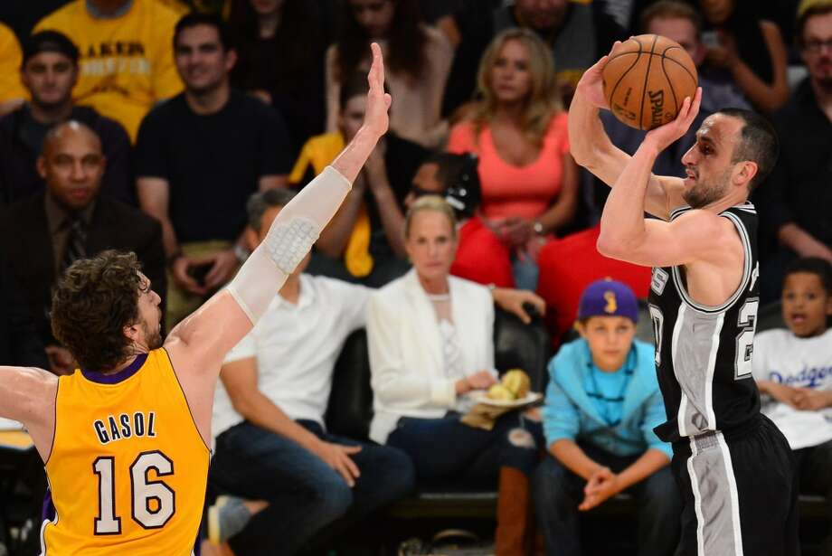 Pau Gasol (L) of the Los Angeles Lakers attempts block the shot by  Manu Ginobili (R) of the San Antonio Spurs during Game Three of the NBA Western Conference Quarterfinal Playoffs at Staples Center in Los Angeles, California on April 26, 2013.