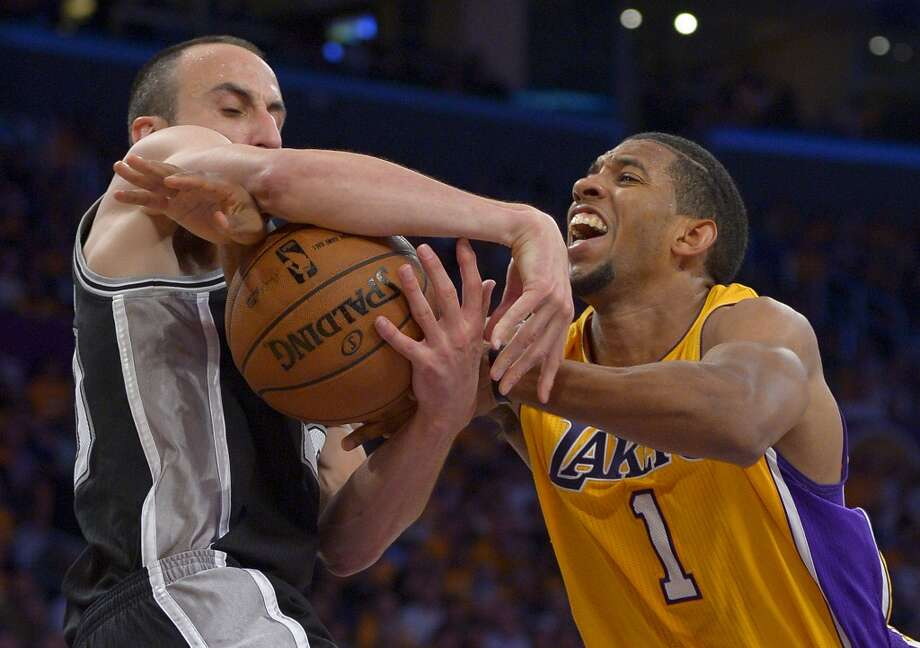 San Antonio Spurs guard Manu Ginobili, of Argentina,, left, and Los Angeles Lakers guard Darius Morris battle for a loose ball during the second half in Game 3 of a first-round NBA basketball playoff series, Friday, April 26, 2013, in Los Angeles.