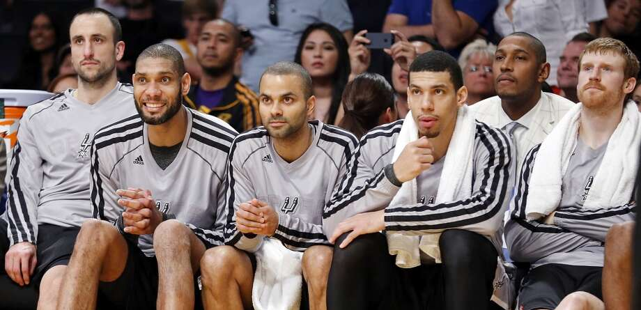 San Antonio Spurs' Manu Ginobili (from left) San Antonio Spurs' Tim Duncan, San Antonio Spurs' Tony Parker, San Antonio Spurs' Danny Green, San Antonio Spurs' Boris Diaw and San Antonio Spurs' Matt Bonner watch second half action of game 4 in the first round of the NBA Playoffs against the against the Los Angeles Lakers from the bench Sunday April 28, 2013 at the Staples Center in Los Angeles, CA. The Spurs won 103-82.