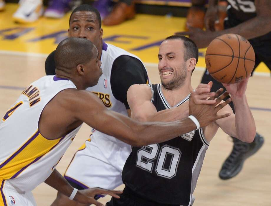 Manu Ginobili (R) of the San Antonio Spurs plays against Antawn Jamison of the Los Angeles Lakers during Game Four of the NBA Western Conference Quarterfinal Playoffs at Staples Center in Los Angeles, California on April 28, 2013.