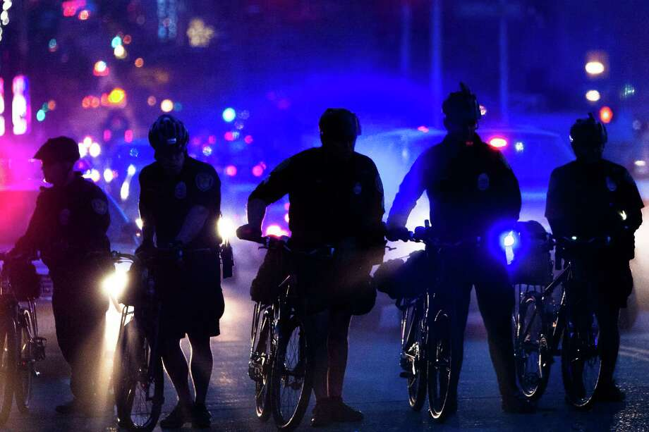 A line of police push protesters up into Capitol Hill. Photo: JORDAN STEAD, SEATTLEPI.COM / SEATTLEPI.COM