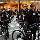 Police form a line in downtown Seattle.