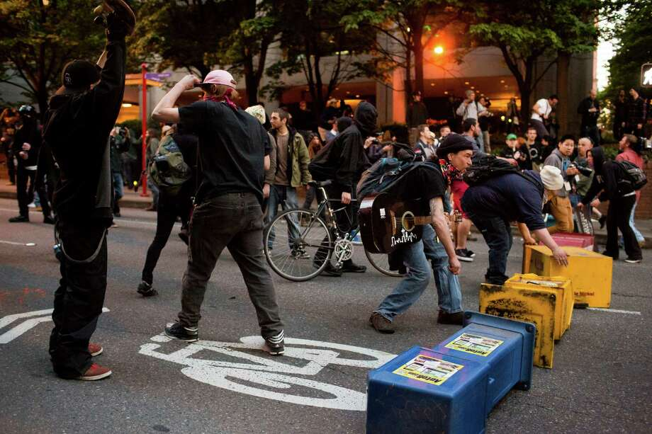 Police and protesters clash during May Day riots Wednesday, May 1, 2013, in Seattle. By late evening, police reported that 18 persons had been arrested for assault and property damage. Eight police officers were hurt. Photo: JORDAN STEAD, SEATTLEPI.COM / SEATTLEPI.COM