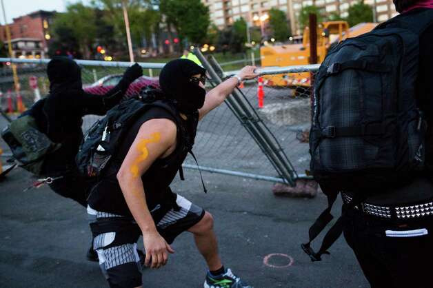 Protesters unsuccessfully attempt to pull down a fence on the way to Capitol Hill during the May Day march. Photo: JORDAN STEAD, SEATTLEPI.COM / SEATTLEPI.COM