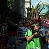 Dancers head up a peaceful May Day march.