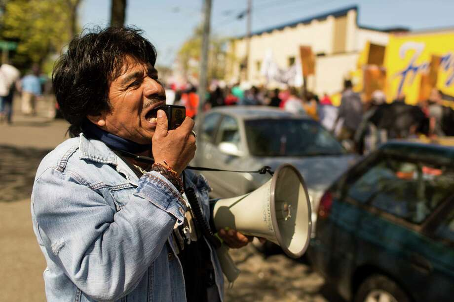 "Marchers took to megaphones, chanting ""Si se puede"" during peaceful May Day procession. Photo: JORDAN STEAD, SEATTLEPI.COM / SEATTLEPI.COM"