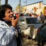 """Marchers took to megaphones, chanting """"Si se puede"""" during peaceful May Day procession."""